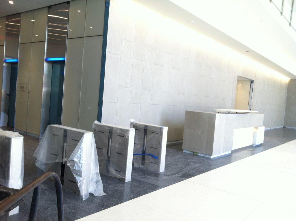 Installation of turnstiles in modern office building in New Jersey.